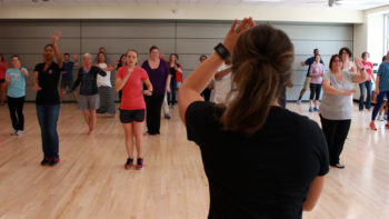 Employees taking a NC State group fitness class