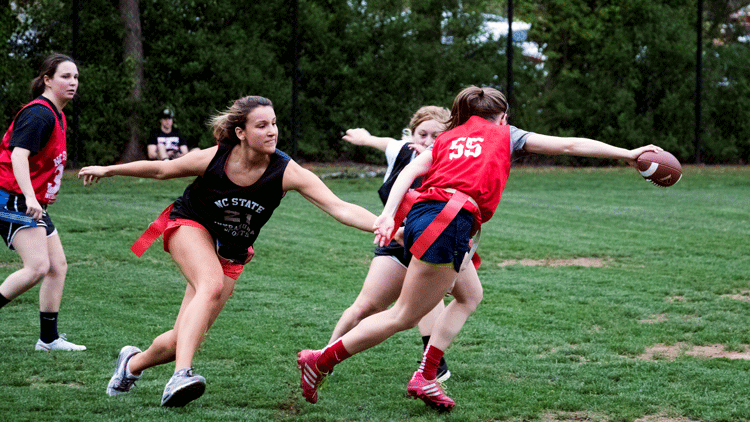NC State students playing intramural sports flag football.