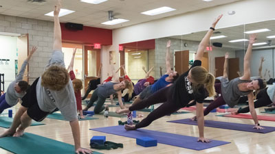 Students taking a yoga class