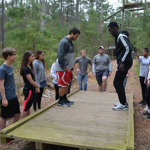 NC State students on low ropes course