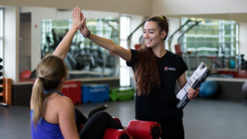 Student With Personal Trainer