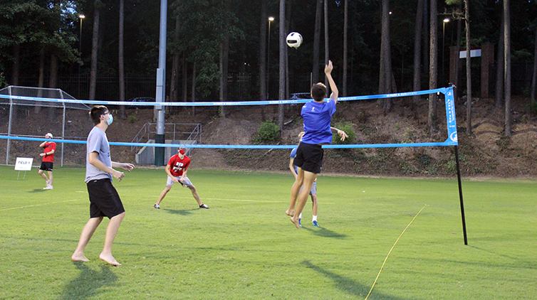Students playing volleyball.